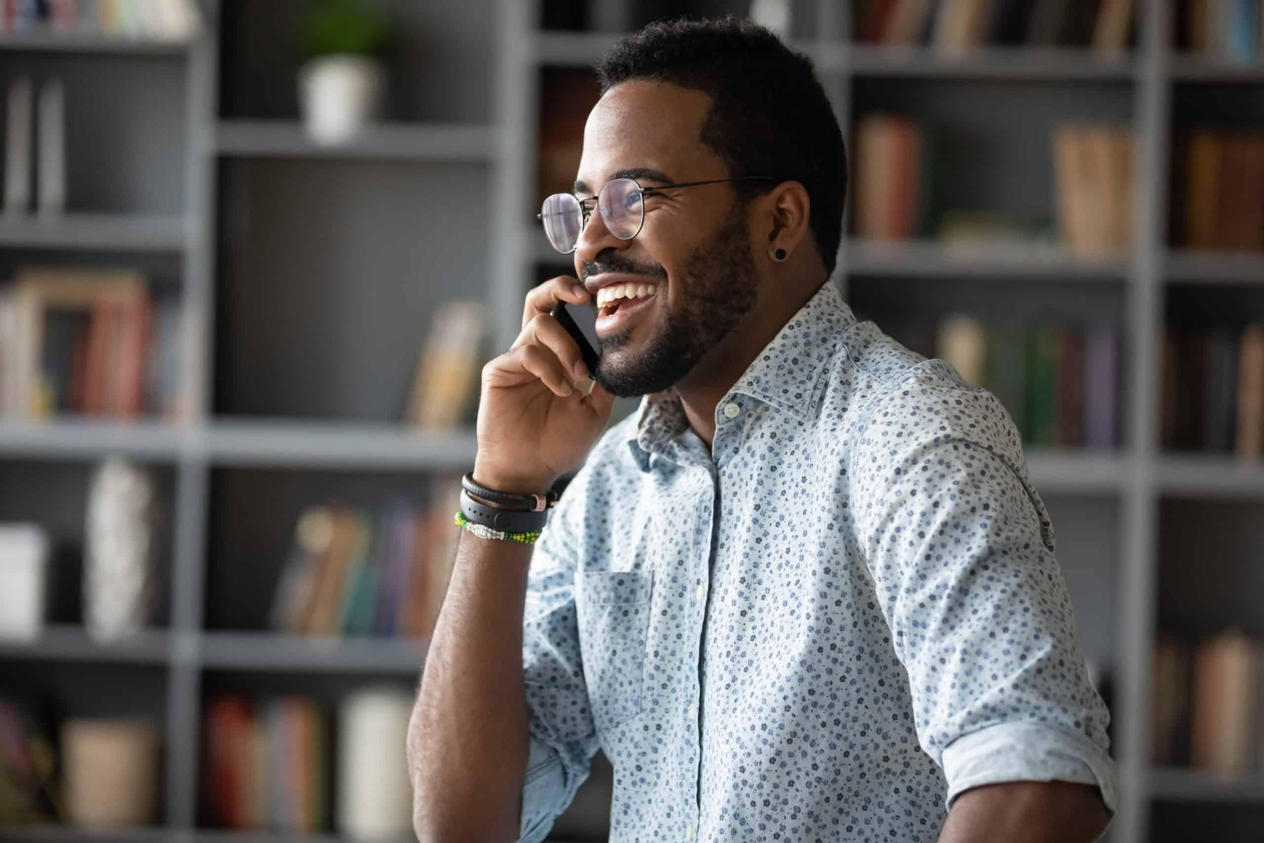 African businessman holding mobile phone enjoy informal conversation