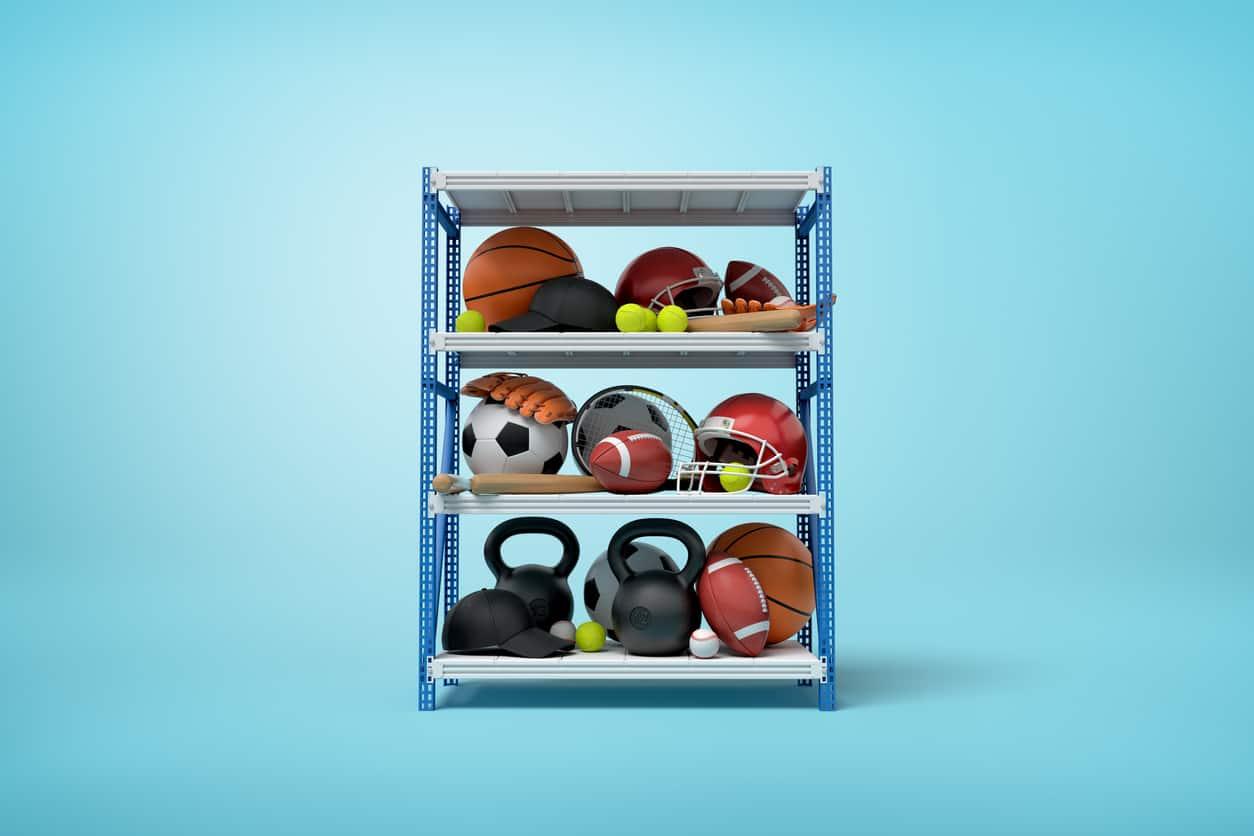 3d rendering of sports balls, helmets and kettlebells on metal rack shelves on blue background
